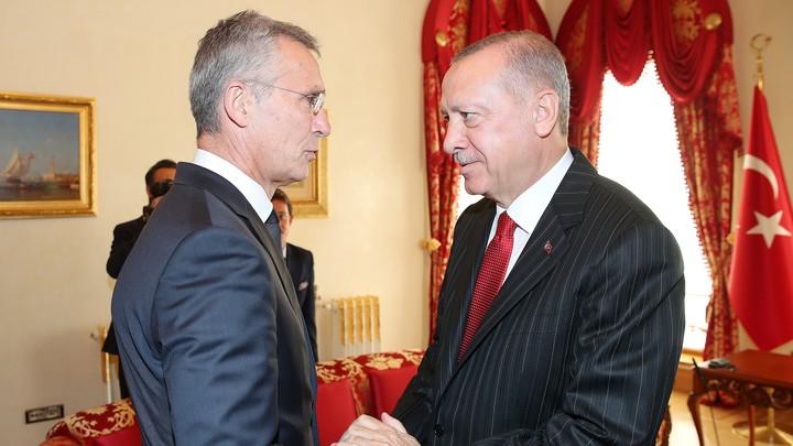 Recep Tayyip Erdoğan shakes hands with Jens Stoltenberg.
