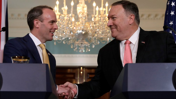 Mike Pompeo (Right) shakes hands with Dominic Raab at the state department in Washington D.C.