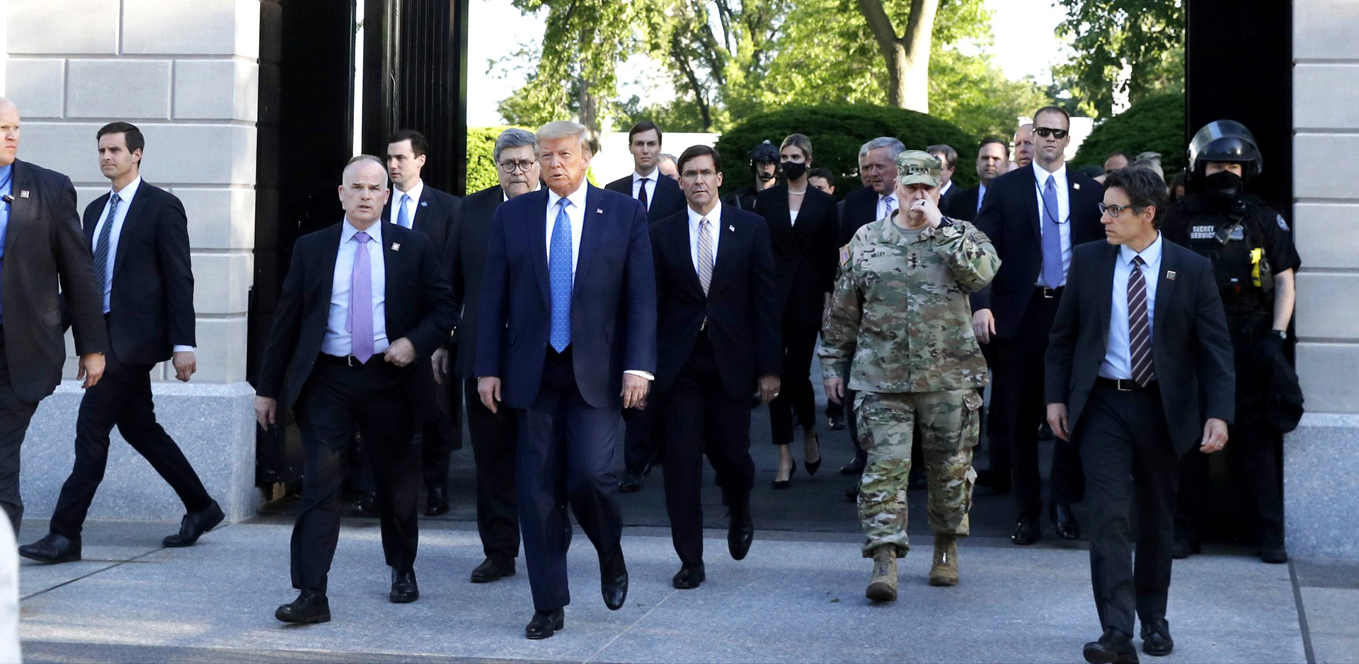 President Trump leads a group of aides on a now-infamous walk across Lafayette Square on June 1, 2020.