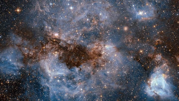 Gas around one of the Milky Way's satellite galaxies glows white.