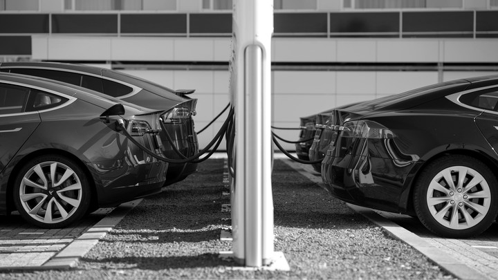 Five Tesla electric cars are shown charging in the Netherlands.