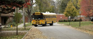 A school bus driving through a suburb.