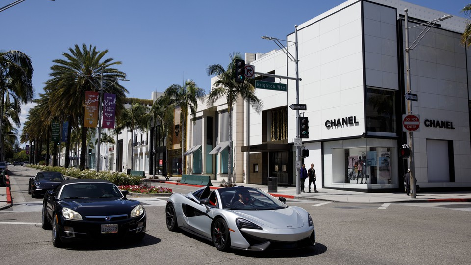Two cars at a shopping mall in California