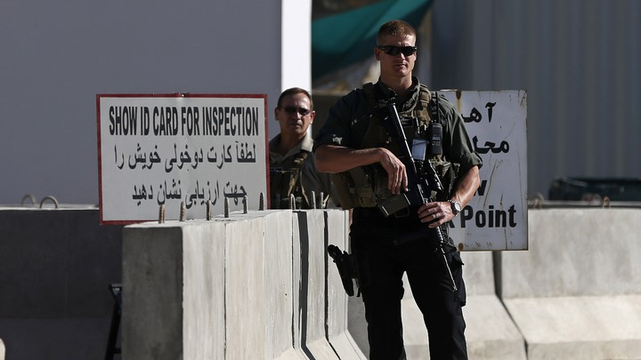 A foreign security contractor stands guard in Kabul.