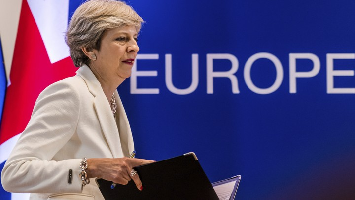 Theresa May speaks at an EU summit in June 2017.