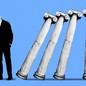 President Joe Biden and Greek columns falling on one another