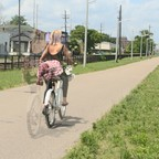 A cyclist on the Lafitte Greenway is pictured.