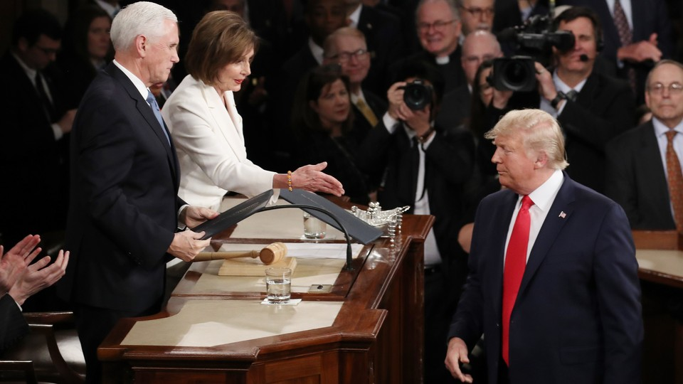 Donald Trump arrives in Congress to deliver the State of the Union. He refuses to shake Nancy Pelosi's hand.