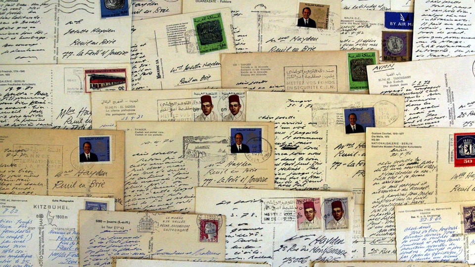 A collage of antique postcards