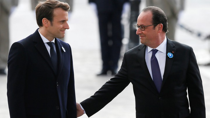 President-elect Emmanuel Macron and outgoing President François Hollande mark the anniversary of Nazi Germany's defeat in World War II at the Arc de Triomphe in Paris on May 8, 2017.