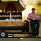 a photo of a street vendor in New Orleans with a load of Lucky Dogs.