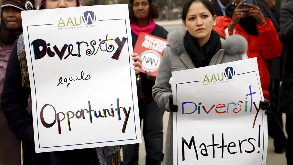 Demonstrators outside the Supreme Court hold signs advocating for diversity.
