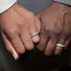 Emma Foulkes, left, and Petrina Bloodworth hold hands and show their wedding rings after being married at the Fulton County Courthouse in Atlanta, after the U.S. Supreme Court struck down Georgia's ban on same-sex marriage