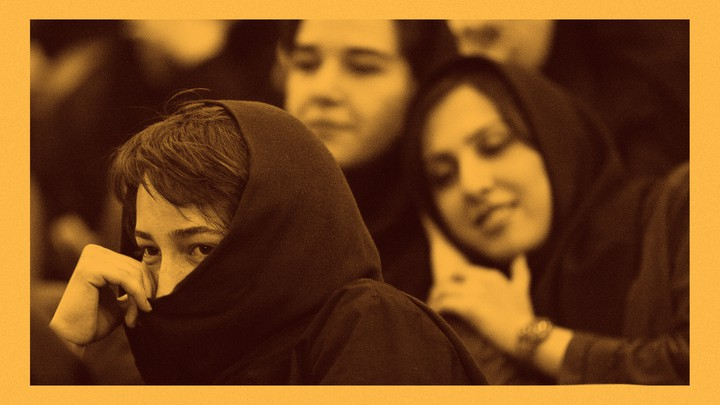 An Iranian student hides her face during a protest against the renewed death sentence of a professor accused of blasphemy, Hashem Aghajari, in 2004 at Tehran University.