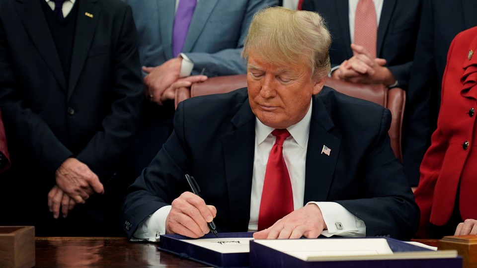 Donald Trump signs the First Step Act and the Juvenile Justice Reform Act in the Oval Office on December 21, 2018.