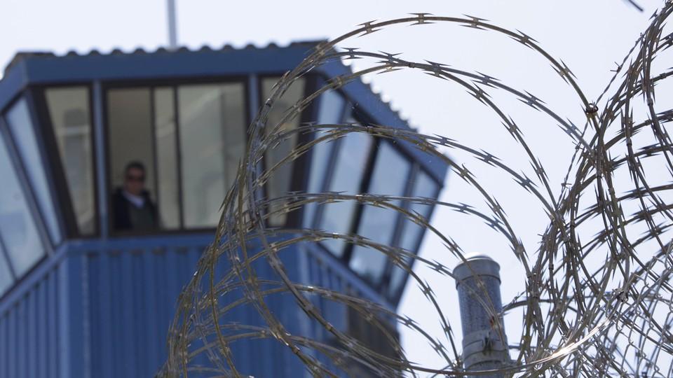 Razor wire atop the fence at a California prison