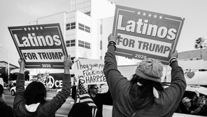 """Two Trump supporters hold placards saying """"Latinos for Trump"""" during a rally in Los Angeles."""