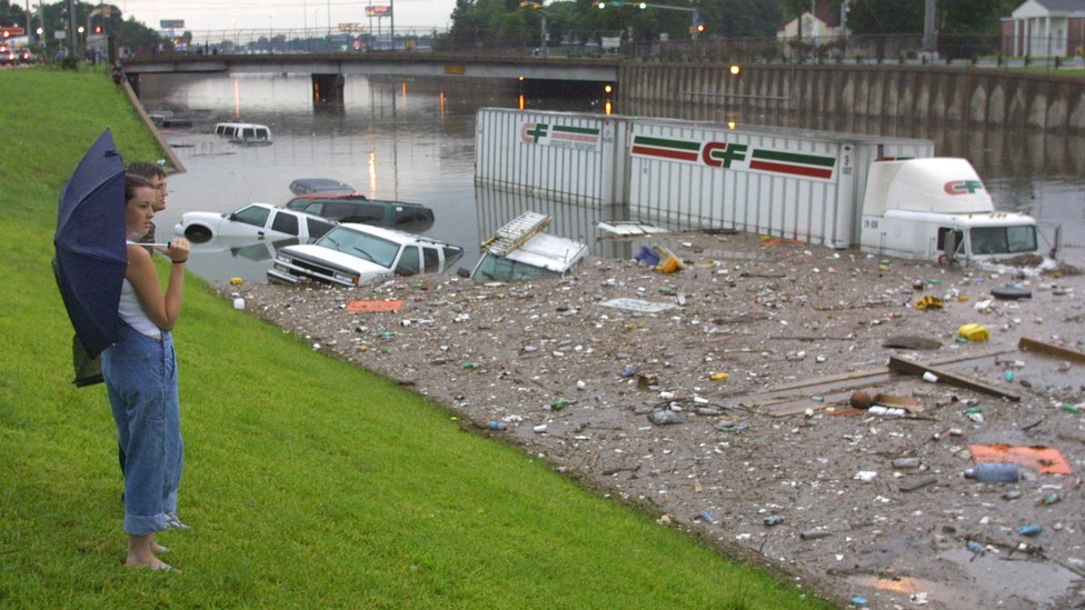 Stranded motorists look over a flooded I-45 North near downtown Houston after tropical storm Allison, in 2001.