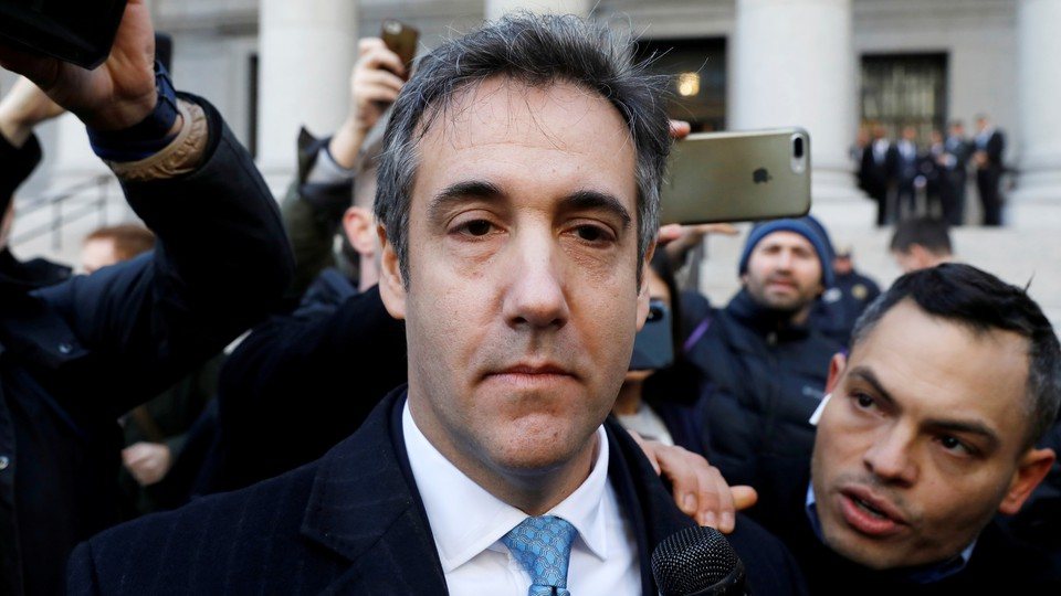 Michael Cohen exits federal court after entering a guilty plea on November 29, 2018.