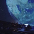 The ClimateMusic Project performs inside the planetarium at Oakland's Chabot Space & Science Center.