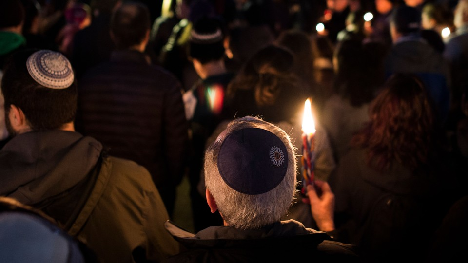 Members and supporters of the Jewish community come together for a candlelight vigil, in remembrance of those who died earlier in the day during a shooting at the Tree of Life Synagogue in the Squirrel Hill neighborhood of Pittsburgh.