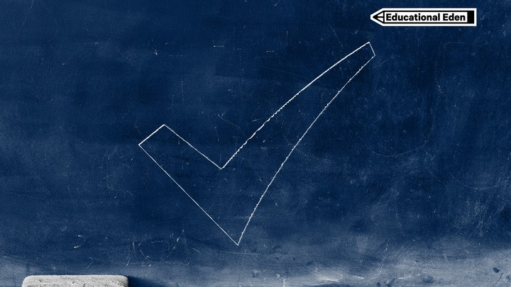 A blue chalkboard with a sketch of a checkmark. There is white chalk and an eraser on the ledge of the chalkboard.