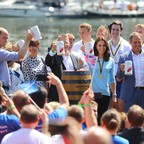 Britain's Prince William and his wife Catherine, the Duchess of Cambridge, and others raise beer mugs after a boat race in Heidelberg, Germany, in July 2017.