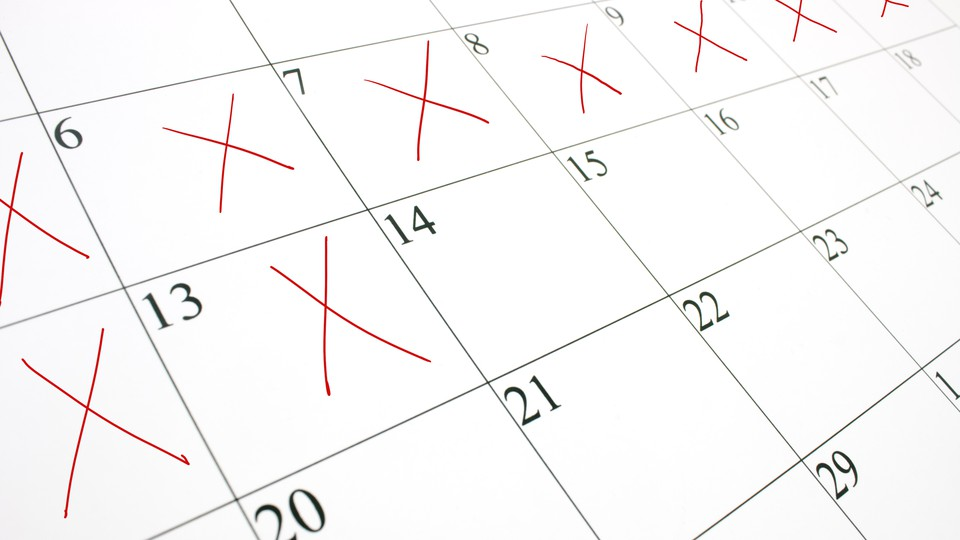 A close-up picture of a calendar with several days crossed off