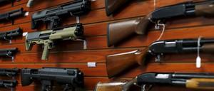 Shotguns are shown for sale at the AO Sword gun store in El Cajon, California.