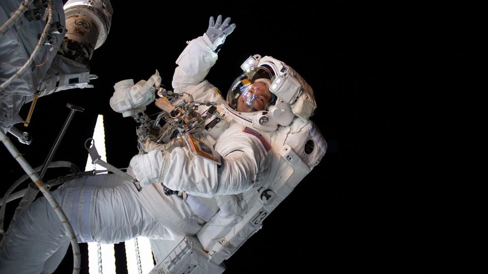 The astronaut Drew Morgan waves during a spacewalk.