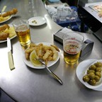 Tapas and beers are served at a restaurant in the Andalusian capital of Seville, southern Spain