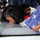 Myeshia Johnson kisses the casket of her husband, Sergeant La David Johnson.