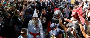 Riot police protect members of the Ku Klux Klan from counter-protesters