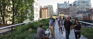 Tourists walk along the High Line in Manhattan, New York City