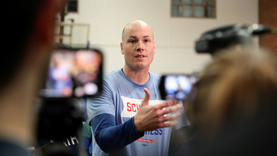 The congressional candidate J. D. Scholten talks to reporters.