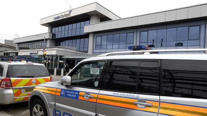 Police cars parked outside London City Airport on Tuesday