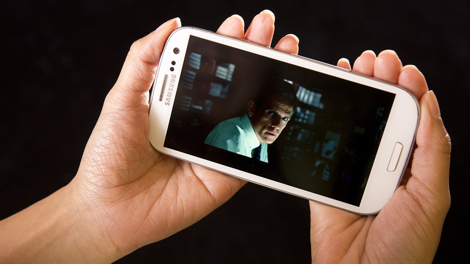 The HULU Plus app displays an image of Ben Stiller as it plays a movie trailer for the film 'The Secret Life of Walter Mitty' on a Samsung Galaxy phone