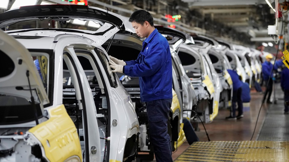 Employees work at a General Motors plant in China.