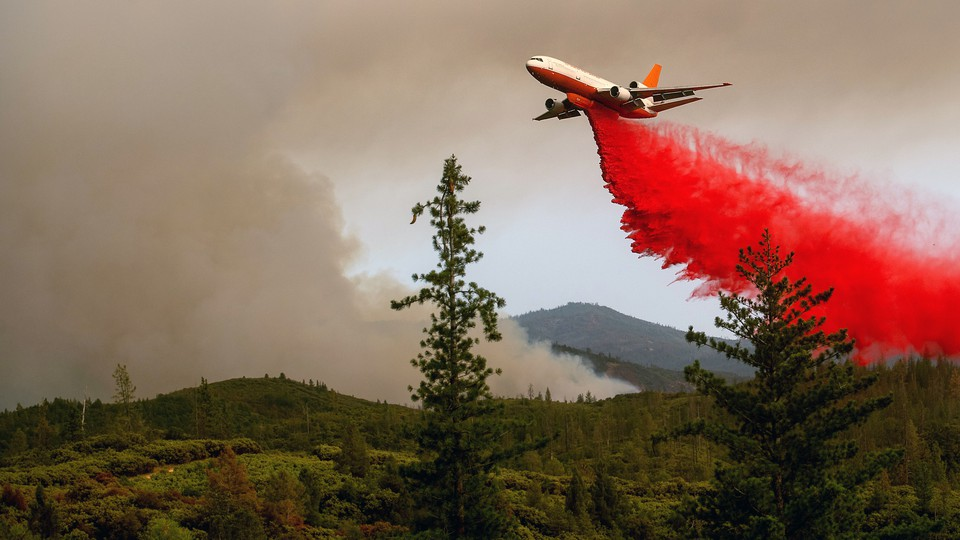 An air tanker drops retardant while battling the Ferguson Fire in the Stanislaus National Forest, near Yosemite National Park, California, on July 21, 2018.