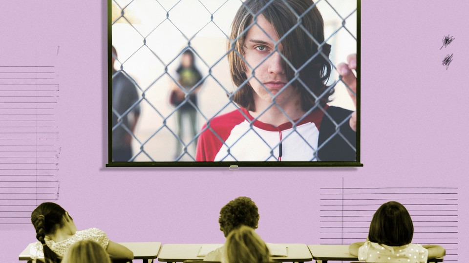 """A frame from the documentary """"Bad Kids"""" fills the screen of a projector in a classroom."""