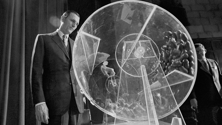 Draft Director Curtis W. Tarr spins a Plexiglas drum in 1972 as the fourth annual Selective Service lottery begins.