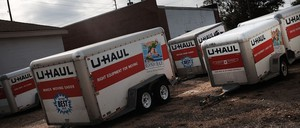 Moving trailers sit in a parking lot in Biloxi, Mississippi