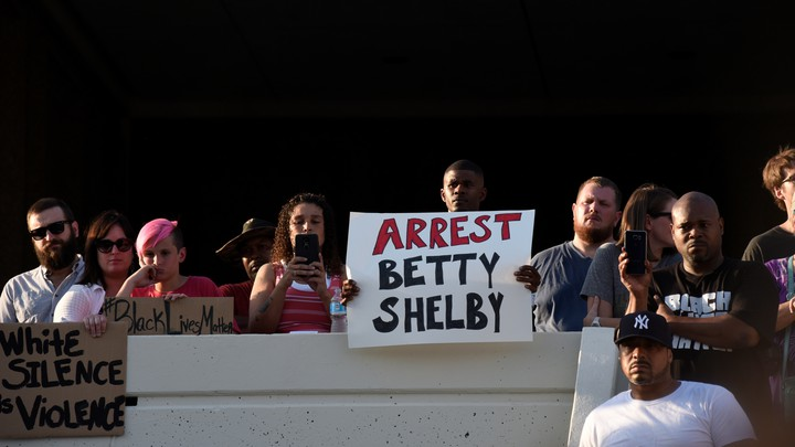 Protesters call for the arrest of Betty Shelby, the officer who fatally shot Terence Crutcher, outside police headquarters in Tulsa, Oklahoma.