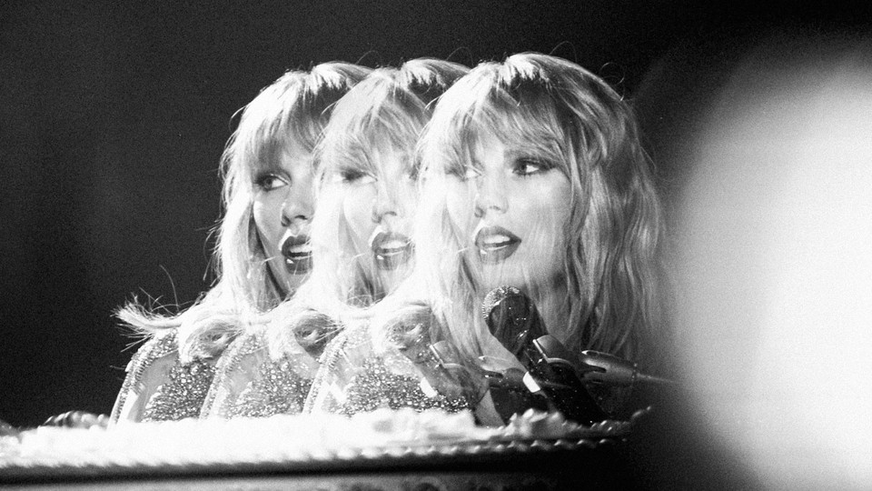 A stylized, black-and-white photo of Taylor Swift singing into a microphone