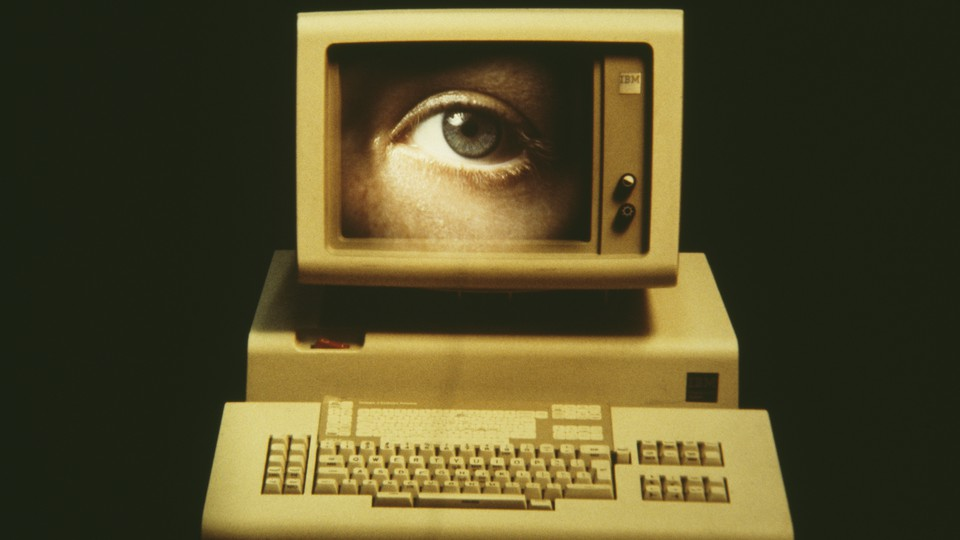 image of a computer with an eye on the screen