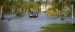 A law enforcement vehicle patrols a flooded street of in Everglades City, Florida, September 11, 2017