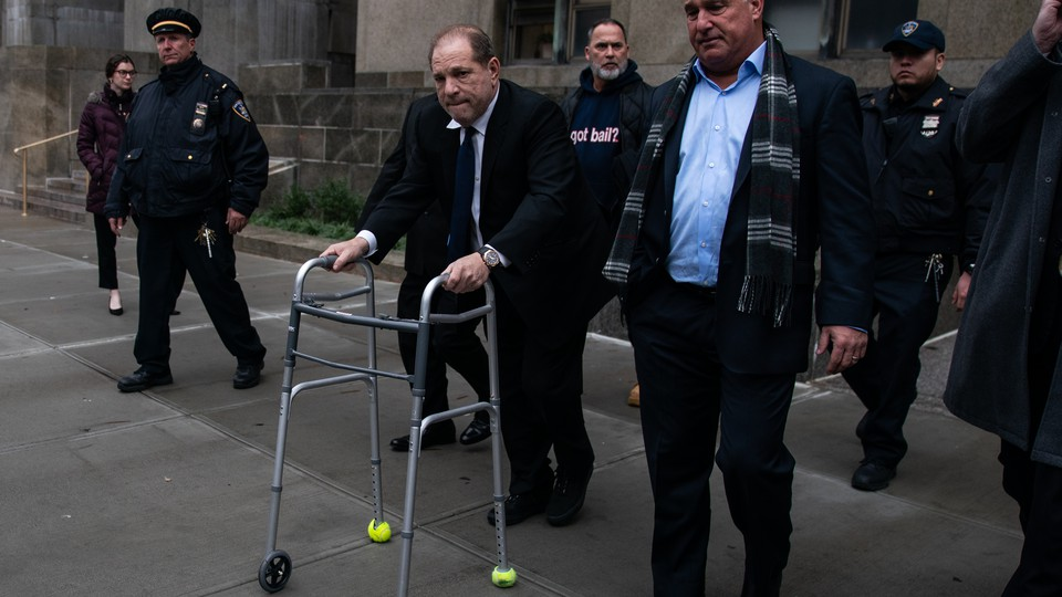Harvey Weinstein, with the aid of a walker, leaves court following a December 11, 2019, hearing in New York City.
