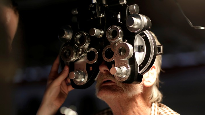 Someone receives an eye exam.