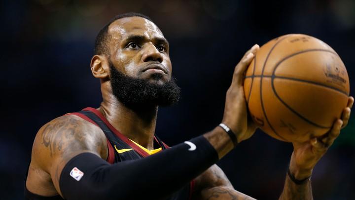 The Cleveland Cavaliers forward LeBron James attempts a free throw against the Boston Celtics during a May 2018 game
