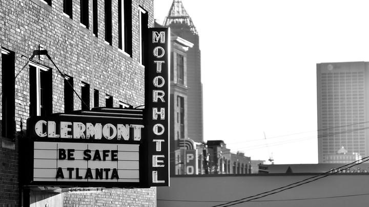 "A hotel displaying a ""Be Safe Atlanta"" sign in Atlanta, Georgia."